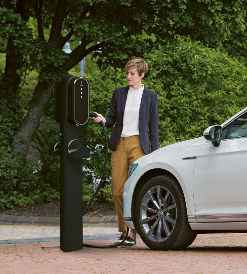 An innogy commercial EV charging unit connected to a BMW i3 vehicle