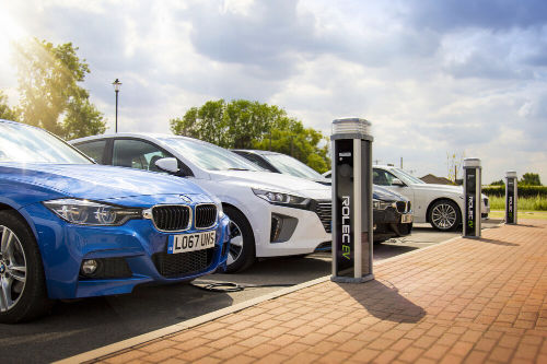 A row of cars charging at commercial Rolec EV charging units